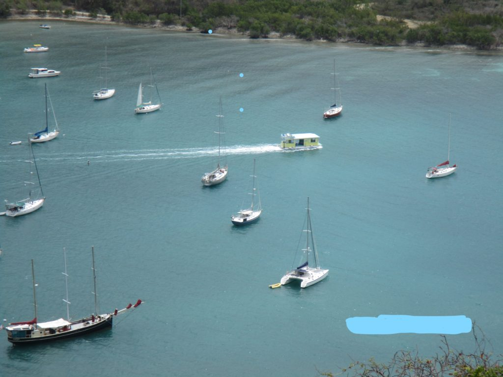 Out of Coral Bay in St. John, a floating bar makes its way to a beach. Will Vicki's be there ?