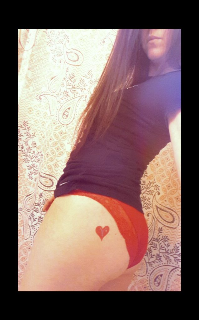 Kelly showing off her V-Heart tat on her left bun with pretty red matching panties