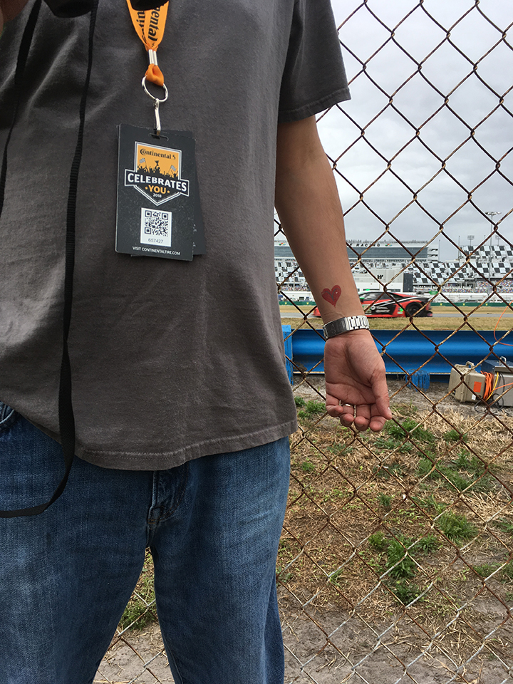 While watching road racing at the 24 hours of Daytona, a V-heart tattoo was spotted on the wrist of a fan standing by the fence.