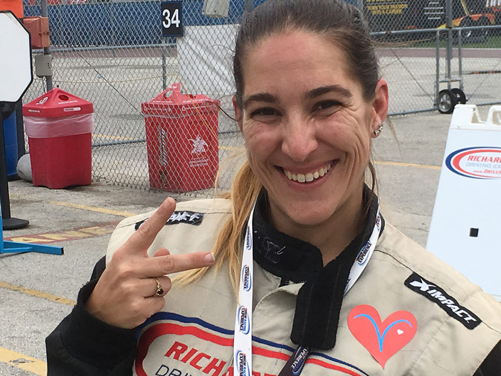 Vgirl Jenna is suited up and ready to drive the speedway wearing a Vheart and a big smile !