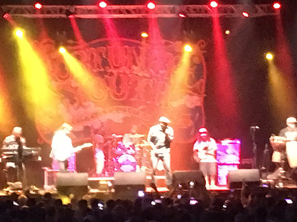 Live performance shot of reggae band Fortunate Youth kicking it up at Jannus Live in St Pete