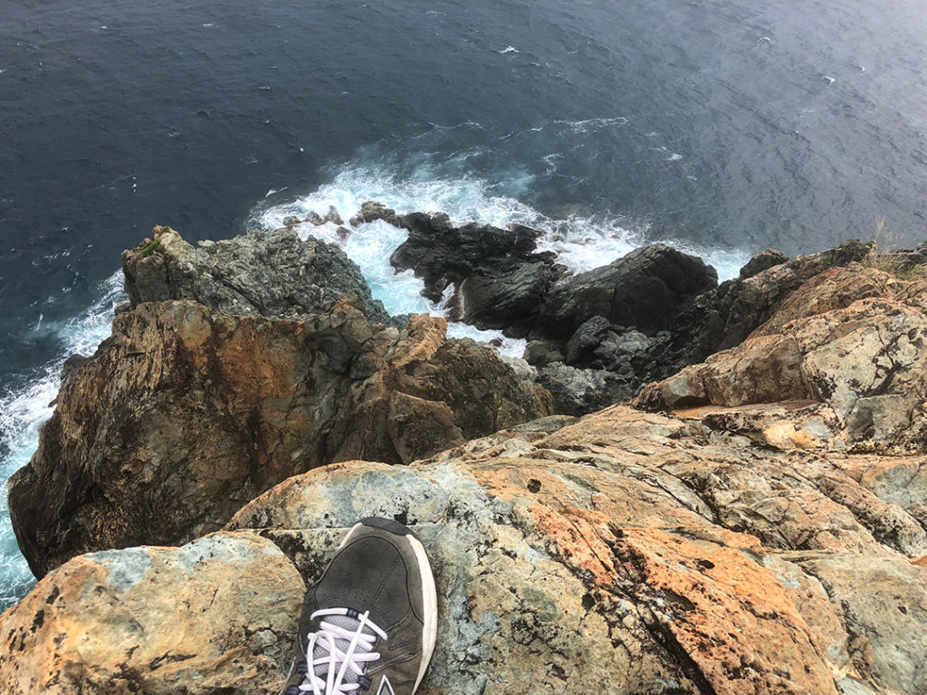 looking down at my foot and 100 ft below to the water at Ram Head, St. John USVI